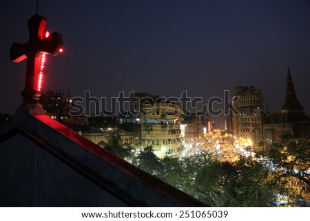KOLKATA, INDIA - FEB 10: Dark city traffic blurred in motion at late evening on crowded streets, view from the Catholic Cathedral on February 10, 2014 in Kolkata  - stock photo