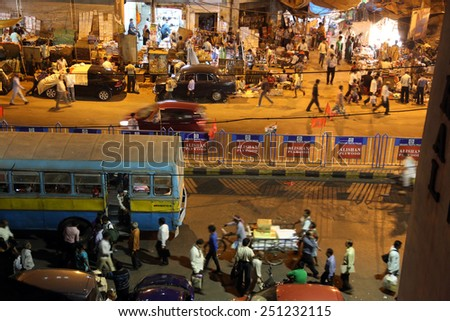 KOLKATA, INDIA - FEB 10: Dark city traffic blurred in motion at late evening on crowded streets on February 10, 2014 in Kolkata. Kolkata has a density of 814.80 vehicles per km road length - stock photo