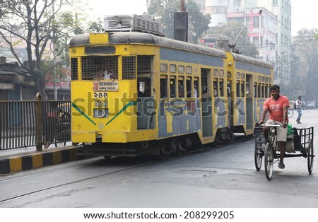 KOLKATA, INDIA - FEB 15: Traditional tram downtown Kolkata on February 15, 2014. Kolkata is the only Indian city with a tram network, which is operated by the Calcutta Tramways Comp. - stock photo