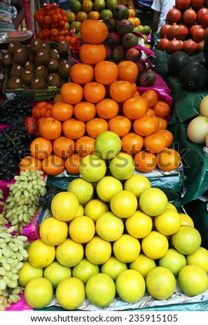 KOLKATA, INDIA - FEBRUARY 15: Street trader sell fruits outdoor on February 15, 2014 in Kolkata India. Only 0.81% of the Kolkata's workforce employed in the primary sector (agriculture)  - stock photo