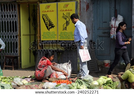 KOLKATA, INDIA - FEBRUARY 12: Street trader sell vegetables outdoor on February 12, 2014 in Kolkata India. Only 0.81% of the Kolkata's workforce employed in the primary sector (agriculture) - stock photo