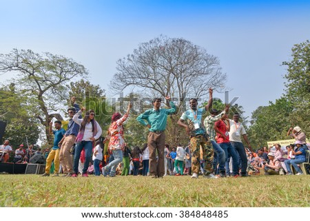 KOLKATA , INDIA - FEBRUARY 8, 2015 : Young crowd from different cultures across the world, are dancing in Sufi Sutra International Dance festival on field. It's a big annual dance program in Kolkata.
