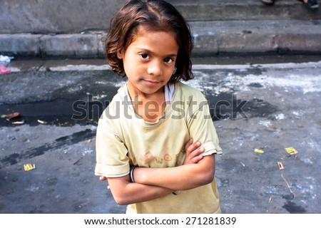 KOLKATA, INDIA - JAN 17: Unidentified child looks calm and happy on January 17, 2012 in West Bengal. Kolkata's literacy rate of 87.14% exceeds the all-India average of 74%. - stock photo