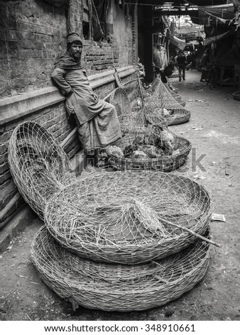 kolkata,India-january 29 2013:men selling chickens at the street around an old market in Kolkata,West Bengal,India. - stock photo