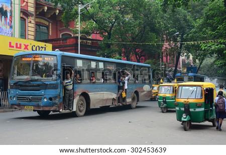 KOLKATA, INDIA - JUL 8, 2015. Vehicles and people on street in Kolkata, India. Kolkata metropolitan area is spread over 1,886.67 km2. - stock photo