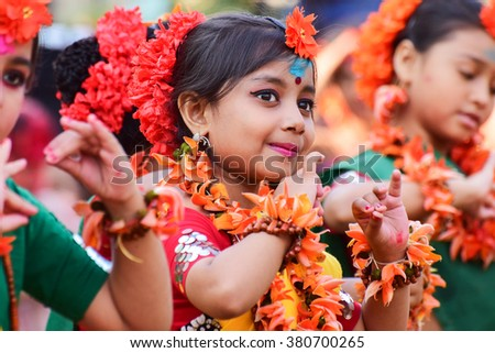 KOLKATA , INDIA - MARCH 5, 2015 : Girl child dancers performing at Holi / Spring festival, known as Dol (in Bengali) or Holi (in Hindi) celebrating arrival of Spring in India. A very popular festival. - stock photo