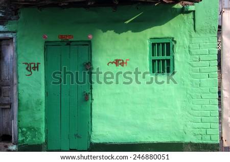 KOLKATA, INDIA - NOVEMBER 23: Colorful Indian house. Bright green building in Kolkata, West Bengal, India on February 23, 2012. - stock photo