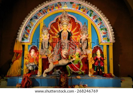 Kolkata, India - 11 October 2013:  An idol of revered goddess Durga standing in an unidentified pandal in the city of Kolkata during Durga Puja festival. A pandal is a temporary temple, erected during - stock photo