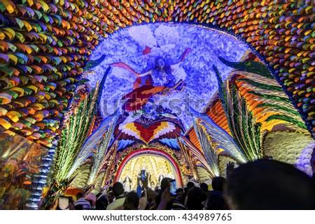 KOLKATA , INDIA - OCTOBER 18, 2015 : Night image of decorated Durga Puja pandal, shot at colored light, at Kolkata, West Bengal, India.Biggest religious festival of Hinduism. Shot under colored light. - stock photo