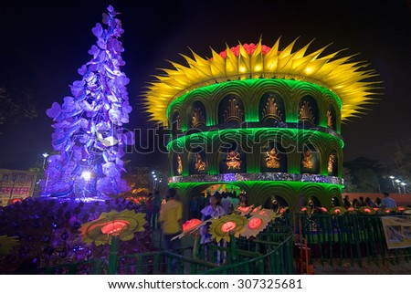 KOLKATA , INDIA - OCTOBER 1, 2014 : People enjoying outside Durga Puja Pandal (decorated temporary temple). Biggest religious festival of Hinduism and local Bengali community, documentary editorial. - stock photo