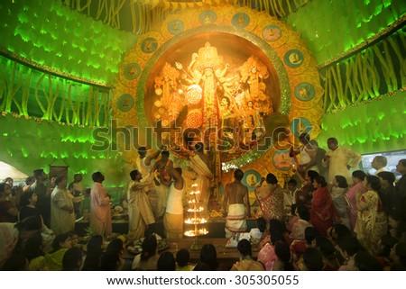 KOLKATA , INDIA - OCTOBER 2, 2014 : Priests praying to Goddess Durga, Durga Puja festival celebration. It is the biggest religious festival of Hinduism and Bengali Community. Documentary editorial. - stock photo
