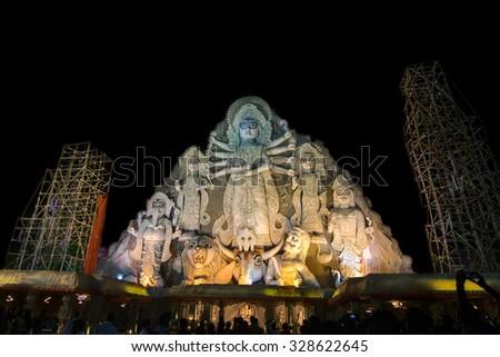 KOLKATA , INDIA - OCTOBER 18, 2015 : World's biggest Durga idol at Durga Puja festival, 70 feet tall, made of clay in Kolkata, West Bengal, India. Biggest religious festival of Hinduism.  - stock photo