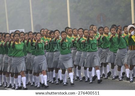 KOLKATA - JANUARY 19 : North Eastern origin girls in their school uniform marching during the Republic Day Parade preparation on January 19, 2015 in Kolkata, India. - stock photo