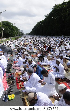 KOLKATA- JULY 28: Muslims gathered on the Red Road during the EID festival to break their one month fast  on July  28, 2014 in Kolkata, India. - stock photo