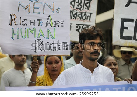 KOLKATA - NOVEMBER 15 :  A muslim woman carrying  men's day signs during a rally to celebrate the International Men's Day on November 15, 2014 in Kolkata, India. - stock photo