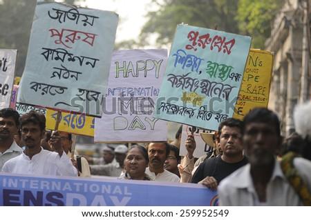 KOLKATA - NOVEMBER 15 : Men and women walking during a rally to celebrate the International Men's Day on November 15, 2014 in Kolkata, India. - stock photo