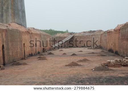 KOLKATA - OCTOBER 26 : A brick factory lying idle just before the production season begins on October 26, 2014 in Kolkata , India. - stock photo
