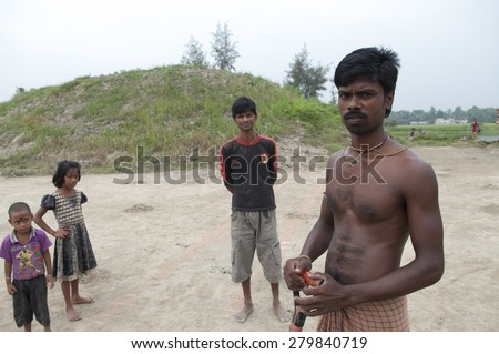 KOLKATA - OCTOBER 26:Families inside a brick factory gathered where they work and stay in tough conditions without any safety or social security on October 26,2014 in Kolkata,India. - stock photo