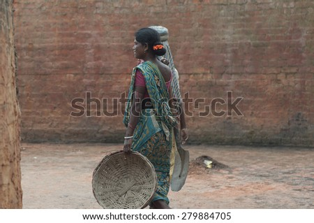 KOLKATA - OCTOBER 26 : Women workers walking inside a brick factory where the work under unhealthy and unsafe conditions on October 26, 2014 in Kolkata , India. - stock photo