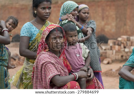 KOLKATA - OCTOBER 26 : Women workers with their kids and families inside a brick factory before the production season begins on October 26, 2014 in Kolkata , India.  - stock photo
