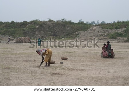 KOLKATA - OCTOBER 26 : Women workers working in a brick factory where they work for minimum wages and without any kind of social security on October 26, 2014 in Kolkata , India. - stock photo