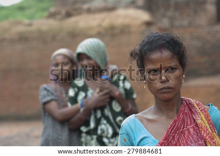 KOLKATA - OCTOBER 26 : Women workers working in brick manufacturing industry where they live and work under unhealthy and unsafe conditions on October 26, 2014 in Kolkata , India. - stock photo