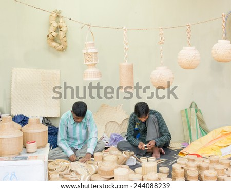 KOLKATA, WEST BENGAL , INDIA - DECEMBER 12TH 2014 : Unidentified persons making Cane furnitures , handicrafts on display during the Handicraft Fair in Kolkata - the biggest handicrafts fair in Asia. - stock photo