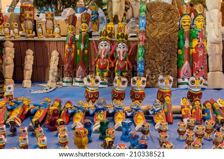 KOLKATA, WEST BENGAL , INDIA - JANUARY 12TH 2014 : Wooden Artworks of handicraft, on display during the Handicraft Fair in Kolkata - the biggest handicrafts fair in Asia. - stock photo