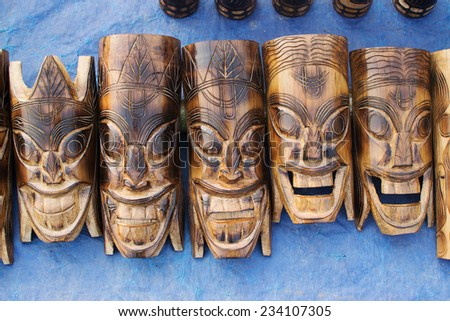 KOLKATA, WEST BENGAL , INDIA - NOVEMBER 23RD 2014 : Wooden masks of handicraft, on display during the Handicraft Fair in Kolkata. It's the biggest handicrafts fair in Asia. - stock photo