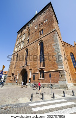 KOLOBRZEG, POLAND - JULY 14, 2015: Frontage of the Basilica of the Assumption of the Blessed Virgin Mary, the Roman-Catholic temple built in the fourteenth century Gothic style - stock photo