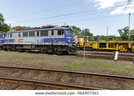 KOLOBRZEG, POLAND - JUNE 23, 2016: EP07 electric locomotive is painted in white blue colors of PKP Intercity it is at the side track of the train station in the city