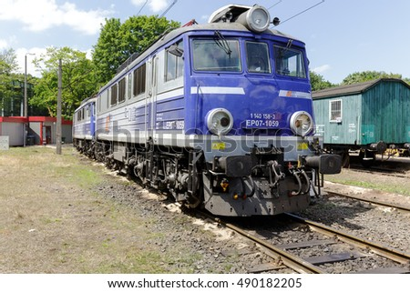 KOLOBRZEG, POLAND - JUNE 23, 2016: EP07 electric locomotive is painted in white blue colors of PKP Intercity it is parked at the side track of the train station in the city