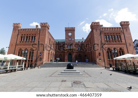 KOLOBRZEG, POLAND - JUNE 23, 2016: View  towards front facade of the neo-Gothic building of Town Hall that was built from 1829 to 1832 and rebuilt in 1913