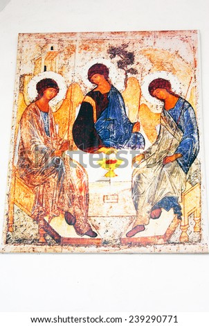 KOLOMNA, RUSSIA - AUGUST 16, 2014: Trinity icon. Old religious painting on the church facade. Kremlin in Kolomna, Moscow region, Russia. Popular touristic landmark, place for walking, historic place. - stock photo