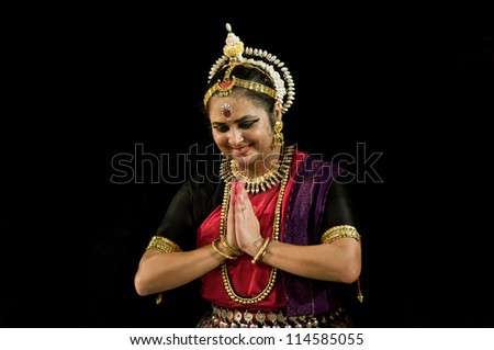 KONARK, INDIA - SEPTEMBER 24: An unidentified lady dancer wears traditional costume and performs Odissi dance at Konark temple on September 24, 2012 in Konark, Orissa, India