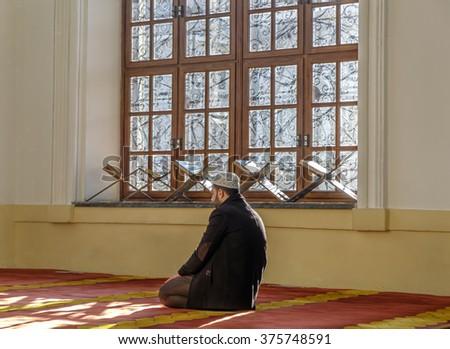 KONYA, TURKEY - FEBRUARY 10: An unidentified muslim man pray Aziziye Mosque on February 10, 2016 in Konya, Turkey. The mosque built by Sultan Abdulaziz's mother Hatun Pertevniyal was opened in 1874. - stock photo