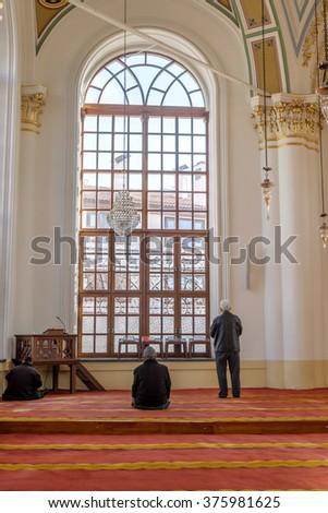 KONYA, TURKEY - FEBRUARY 10: An unidentified muslim man prays Aziziye Mosque on February 10, 2016 in Konya, Turkey. The mosque built by Sultan Abdulaziz's mother Hatun Pertevniyal was opened in 1874. - stock photo