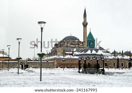 KONYA, TURKEY- NOVEMBER 26, 2014: Mevlana museum and sufi center in Konya, Turkey on November 26, 2014. Tomb of Mevlana, the founder of Mevlevi sufi dervish order, with prominent green tower in Konya. - stock photo