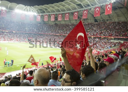 Konya, Turkey - SEPTEMBER 3 Turkish-Latvian fans during the EURO 2015 soccer game on September 6, 2011 in Konya, Turkey. The game is a draw. - stock photo