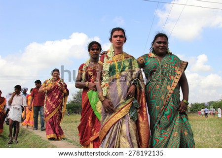 KOOVAGAM, INDIA - MAY 06: Unidentified transgenders participates in a ritual to mourn the death of Lord Aravan in their festival held at Koothandavar temple on May 06, 2015 in Koovagam,Tamil Nadu. - stock photo