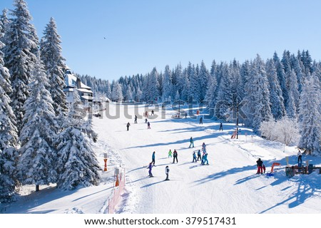 Kopaonik, Serbia - January 22, 2016: Panorama of ski resort Kopaonik, Serbia, ski slope, people skiing, houses covered with snow