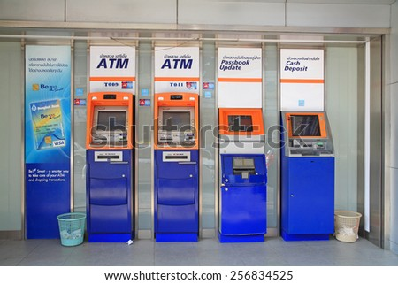 KORAT, THAILAND - FEBRUARY 21, 2015: Bangkok Bank ATM, Passbook update, and Cash deposit Automatic machine. Bangkok Bank is the 3rd largest Thai banking following SCB and Kasikornbank. - stock photo