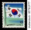 KOREA-CIRCA 1993:A stamp printed in Korea shows image of The flag of South Korea, or Taegeukgi has three parts: a white background; a red and blue taegeuk in the centre, circa 1993. - stock photo