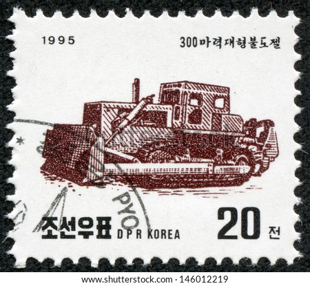 "KOREA - CIRCA 1995: A stamp printed in North Korea shows a Bulldozer, without the inscription, from the series ""Building machines"", circa 1995 - stock photo"