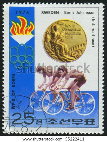 KOREA - CIRCA 1976: stamp printed by Korea,  shows bicycling, circa 1976. - stock photo