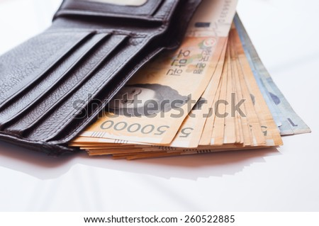 Korea Won currency notes in leather wallet - stock photo