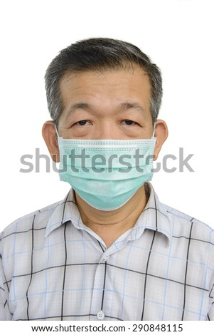 Korean adult wears a protective mask from Mers - stock photo