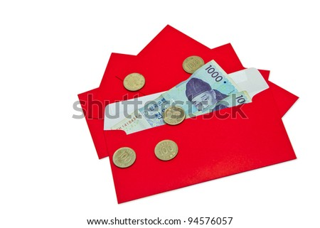 korean banknote in red envelope and coins on white background - stock photo