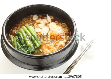 korean cuisine, spicy ramen noodles with spinach and egg - stock photo