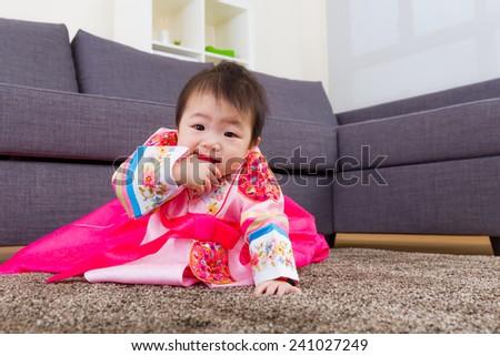 Korean little girl crawl at home - stock photo